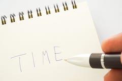 递文字'时间'在笔记本页 免版税图库摄影