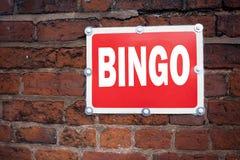 递文字文本显示宾果游戏概念意思字法的说明启发赌博赢取在老announc写的价格成功 库存图片