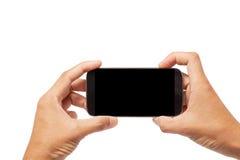 递有黑屏的男性亚洲举行的智能手机在白色ba 免版税图库摄影