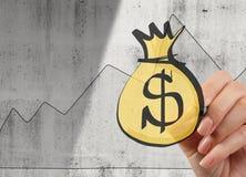 递画的美元的符号袋子和图表在纹理背景 库存图片