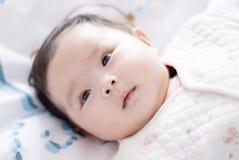 逗人喜爱亚洲的婴孩 免版税库存照片