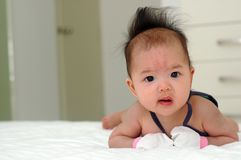 逗人喜爱亚裔的婴孩 图库摄影