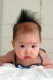 逗人喜爱亚裔的婴孩 库存图片