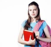 年轻逗人喜爱十几岁的女孩摆在快乐反对白色背景 免版税图库摄影