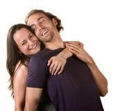 逗人喜爱夫妇拥抱 免版税库存照片