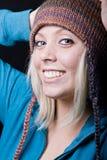 逗人喜爱女孩帽子编织佩带 库存照片