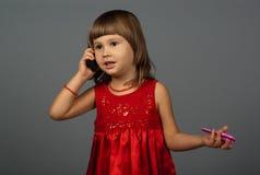 逗人喜爱女孩电话联系 图库摄影