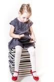 逗人喜爱小女孩使用 免版税图库摄影