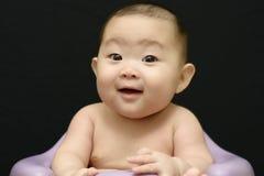 逗人喜爱的中国女婴画象 免版税库存图片