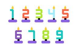 逗人喜爱的五颜六色的数字塑造了被设置的蜡烛 免版税库存照片