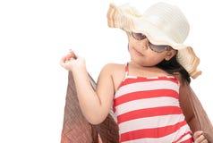 逗人喜爱的亚裔女孩佩带的泳装画象  免版税库存照片