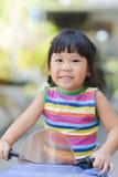 逗人喜爱的亚裔女孩和她的玩具 库存照片