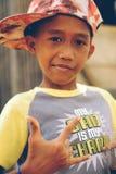 逗人喜爱的亚洲小男孩匪徒样式 免版税库存照片