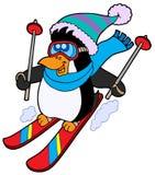逗人喜爱的企鹅滑雪 免版税库存照片
