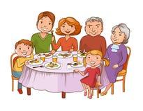 逗人喜爱的动画片家庭用餐在桌上 库存照片