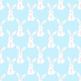 逗人喜爱的动画片兔宝宝无缝的几何样式 免版税库存照片