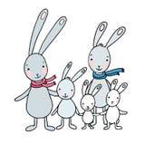 逗人喜爱的动画片野兔家庭  免版税库存图片