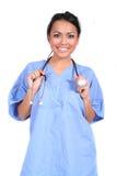 逗人喜爱的医生女性医疗护士工作者 免版税库存照片