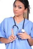 逗人喜爱的医生女性医疗护士工作者 免版税库存图片