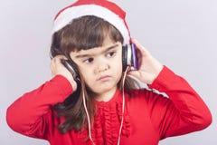 逗人喜爱的圣诞老人女孩 库存图片