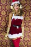 逗人喜爱的圣诞老人妇女 免版税库存图片