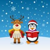 逗人喜爱的圣诞节企鹅和驯鹿 免版税库存照片