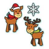 逗人喜爱的圣诞节驯鹿男孩和女孩 库存照片