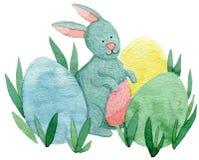 逗人喜爱的复活节兔子用被绘的鸡蛋 免版税库存照片