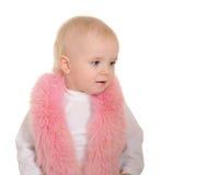 逗人喜爱的女婴在空白背景的桃红色毛皮穿戴了 免版税库存照片