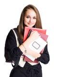 逗人喜爱的女学生年轻人 免版税库存照片