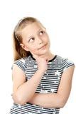 逗人喜爱的女孩一点沉思纵向白色 库存图片
