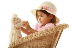 逗人喜爱的女孩她小的玩具 库存照片