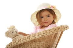 逗人喜爱的女孩她的藏品少许玩具 免版税库存图片