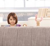 逗人喜爱的女孩小的玩具 免版税库存图片