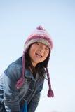 逗人喜爱的女孩帽子一点 库存照片
