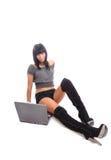 逗人喜爱的女孩查出的膝上型计算机&# 库存图片