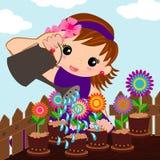 逗人喜爱的女孩浇灌的花 免版税库存图片