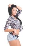 逗人喜爱的女孩牛仔裤短缺 免版税库存照片