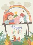 逗人喜爱的女孩用复活节兔子和复活节彩蛋 库存照片