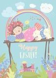 逗人喜爱的女孩用复活节兔子和复活节彩蛋 免版税库存图片