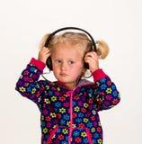 逗人喜爱的女孩耳机 库存照片