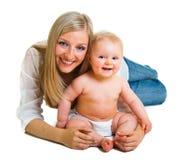 逗人喜爱的女孩藏品婴儿母亲 库存照片