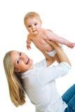 逗人喜爱的女孩藏品婴儿母亲 免版税库存图片
