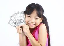 逗人喜爱的女孩藏品货币 图库摄影