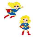 逗人喜爱的女孩超级英雄在飞行中和立姿的 图库摄影
