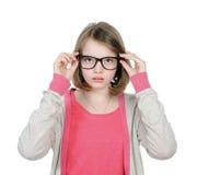 逗人喜爱的女孩戴眼镜观看 库存图片