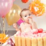 逗人喜爱的女婴庆祝生日一年 图库摄影