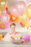 逗人喜爱的女婴庆祝生日一年 库存图片