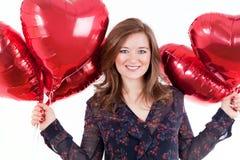 逗人喜爱的妇女画象有气球心脏的Valentinsday 图库摄影