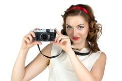 逗人喜爱的妇女的图象有照相机的 图库摄影
